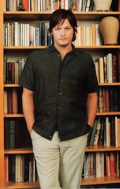 Two of my favorite things. Norman and books. My God thank you for this picture.