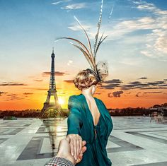 Picture of #FollowMeTo husband and wife Instagrammers at the Eiffel Tower in Paris