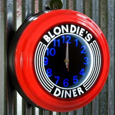 Blondie's Diner Red Lighted Clock | Vintage Diner Clocks | RetroPlanet.com Red Retro Vintage Style Neon kitchen clock  Add some rad, retro style to your kitchen, dining room, or diner with this Blondie's Diner Red Wall Clock. Sporting art deco style that's sure to please any retro fan, this fluorescent clock is backlit and ringed in vivid red. An awesome gift for anyone with a retro kitchen.