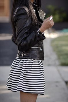 White And Black Outfit: Sheryl Luke is wearing a black leather jacket from Zara and the black and white striped dress is from Shop Akira