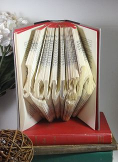 """Paper Folding """"Laugh"""" into Old Book - pinned by pin4etsy.com"""