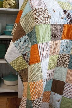 Really sweet quilt. Love the colours/patterns in this.