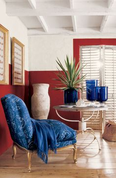 Try a seaside-inspired take on red, white and blue decor. Walls in bold Ralph Lauren Paint National Red and cool Plaster White.