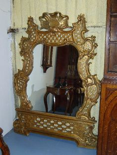 Flamboyant scrolling framed gilt mirror in Rococo style
