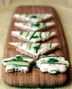 Cucumber Tea Sandwiches, VeganYumYum (pinned for her pretty presentation, no secret to the recipe - bread [rye!], tofutti [or other cream cheese maybe with dill], cucumber)
