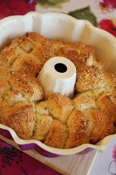 Garlic Parmesan Pull Apart Bread 2 cans buttermilk biscuits  1/2 cup shredded parmesan cheese  1 tsp Italian seasoning  1/2 tsp garlic powder  1 stick butter