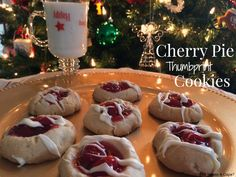 Cherry Pie Thumbprint Cookies scrumptious by Lucky Leaf! A shortbread style cookie topped with Cherry Pie Filling & a drizzle of chocolate, the perfect holiday treat! Raspberry Thumbprint Cookies, Thumbprint Cookies Recipe, Cherry Cookies, Pecan Cookies, No Bake Sugar Cookies, Cake Mix Cookies, Cupcakes, Cookie Pie, Cookie Cups