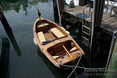 Boat floating peacefully in Nantucket Harbor.
