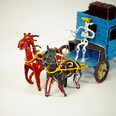 Here's a unique sculpture by an apprentice to the master of paper mache over wire, Saulo Moreno. This amazing stagecoach is carrying two skeletons (novios) inside and is being driven by a third. The brown and black horses are attached to the cab of the coach with a wire harness