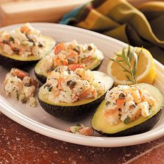 Shrimp Salad-Stuffed Avocados Recipe -This is one of my husband's favorites, even though it's pretty enough to serve at a ladies luncheon. When I needed a quick main-dish salad for my book club, I just tripled the recipe and got raves! Try it with imitation crabmeat, too. —Suzanne VanAlstyne, Petoskey, Michigan