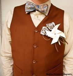 Pinwheel -- Planning a country-themed or barn wedding? Put your groom in a pinwheel boutonniere to match the setting!