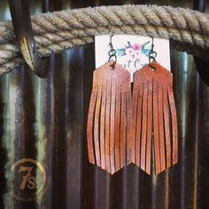- Saddle tan fringe leather earrings - Hand cut fringe - Rustic distressed stained leather - Brass hooks - Handcrafted in Oregon, USA - Shown styled with The Westfall dress, The Gringas boot, Carson N