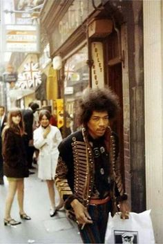 "Jimi Hendrix in  London, 1966 or 1967, possibly Carnaby Street...,those ""birds"" thought he was cool!"