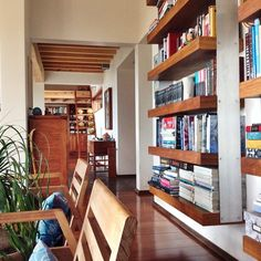 architecture interior home design hallway built-in bookshelves living room natural wood modern contemporary