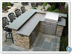 Outdoor Fieldstone kitchen featuring raised stone bar counter and grill incorporated into a backyard patio design. Outdoor Kitchen Bars, Backyard Kitchen, Outdoor Kitchen Design, Patio Design, Backyard Patio, Backyard Barbeque, Outdoor Bars, Grill Design, Simple Outdoor Kitchen