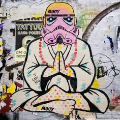 Street Art London. A meditating Stormtrooper, a humorous paste up piece by artist Minty. Grimsby Street, Shoreditch, London, UK. Taken September 2016.