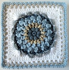 Floral Dimension Afghan Square by Laurie Dale This pattern incorporates puff stitches, clusters and scallops for a fairly solid square. Crochet Square Blanket, Crochet Squares Afghan, Crochet Blocks, Granny Square Crochet Pattern, Afghan Crochet Patterns, Crochet Granny, Crochet Motif, Crochet Designs, Granny Squares