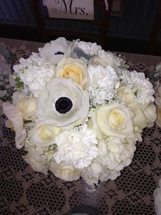 White on white bride's bouquet, with hydrangea, carnations, baby's breath, and black-faced white anemones.  Adorna Design at TerrAdorna.