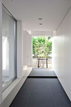 House with a Courtyard in Toyota city, Japan by Freedom Architects _