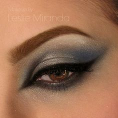 This blend of blue eye shadows paired with a winged cat-eye liner will definitely make your brown eyes pop. Wear this look on a hot date or a night out.