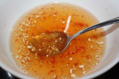 EVERY Khmer household has special-prepared fish sauce for dipping on-hand, ready for use, usually in a giant jar in the fridge. Great for egg rolls, spring rolls, fried and baked fish and much more. (I love this sauce) Vietnamese Sauce, Vietnamese Fish, Vietnamese Cuisine, Vietnamese Recipes, Asian Recipes, Vietnamese Spring Rolls, Vietnamese Egg Rolls, Recipes With Fish Sauce, Sauce Recipes