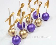 Gold and purple cake pops More