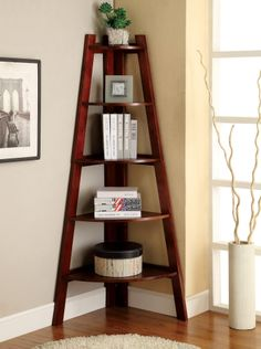Snuggle this Furniture of America Merill Ladder Shelf into any corner to maximize space and create visual drama. This handsome ladder shelf. Ladder Bookshelf, Ladder Display, Corner Shelving, Wood Display, Corner Shelves Living Room, Corner Wall Decor, Wood Ladder, Corner Ladder Shelf, Bookshelf Ideas