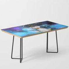 """Built with mid-century modern styling, our coffee table complements any interior aesthetic—from vintage to contemporary. Best of all, the minimalist design lets the artwork shine as your new centerpiece. Legs are available in black or gold options.    - 35.75"""" x 17.75"""" x 17"""" (H)  - Baltic birch table top with beveled edge   - High quality print with satin finish   - Steel legs available in black or gold   - Assembly required Mid-century Modern, Contemporary, Weimaraner, Baltic Birch, Satin Finish, Minimalist Design, Centerpiece, Mid Century, Steel"""