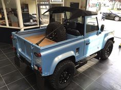 Tophat restored Defender 90 with bikini top