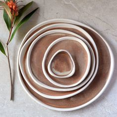 Pebble plates by Kim Wallace Ceramics ~ rust