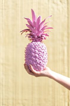 Decorate your Galentine Day brunch party with fun DIY spray-painted tiki-style pink pineapples.