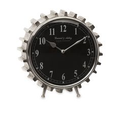 Gearheads everywhere will love this aluminum table clock. With its black face and clean lines, the gear tooth framing makes this clock perfect for an industrial or urban loft decor.