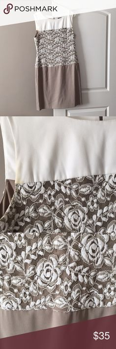 Pretty dress white and beige with laces Pretty dress made by connected apparel white and beige with white laces ,good condition but need a dry cleaning ,I have not washed it worked couple time but white is always hard to keep It clean connected apparel Dresses