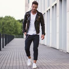 Wear a black leather motorcycle jacket with navy chinos for a casual level of…