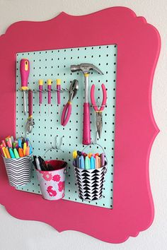 To holster tools, Dawn, the DIY blogger behind Dawn Nicole Designs, used pegboard attached to an old frame to create extra wall storage in her crafts room. She spray-painted the items individually for a fun look and found pegboard organizers at The Home Depot. Re-create your own with her instructions here.