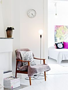 Source: Bohemian Treehouse  Love this! That chair and lamb skin and the floor lamp…….not to mention the white painted floors. I love painted floors. The lamp is called the Cord Lamp and you can get it from Design House Stockholm.