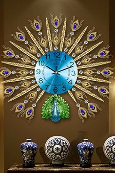 If you love the look of animal wall art or peacock wall decor take a look at this vibrant gold and blue wall clock. Peacock Wall Decor, Metal Wall Decor, Metal Wall Art, Wall Art Decor, Blue Wall Clocks, Unique Wall Clocks, Clock Wall, Interior Design Themes, Wall Clock Design