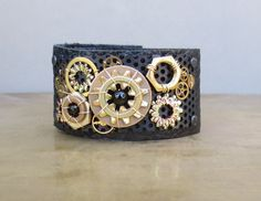 Steampunk Bracelet Cuff of Brass and Bronze Industrial Components on Black Leather Band