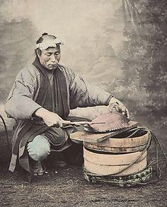 Preparing a fish.  Hand-colored photo, circa 1870's, Japan, by photographer Shinichi Suzuki