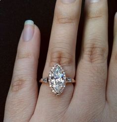 marquise diamond ring with halo and baguette diamons