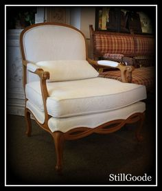 Ethan Allen French Bergere style arm chair with white damask upholstery, bolster throw pillow. - Available at StillGoode! #OnTheShowroomFloor #Chair #Damask #Upholstery #Upholstered #EthanAllen #FrenchBegere #Style #ArmChair #Arm #WhiteChair #White #ThrowPillow #Throw #Pillow #StillGoode