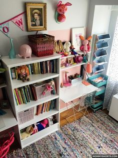My girls share a room with bunk beds. To create individual areas, we gave them each a desk to set up with their favorite things. They were thrilled! To save space, we hung tiered shelves on the wall above each desk.