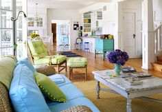 Adore this beach-y space! Love all of the turquoise and lime green against the white. It's all so crisp and refreshing!