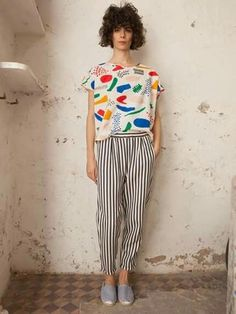 Bobo choses - Pattern on shirt and lines on pants surprisingly work well together in one outfit. The lines on the pants are vertical almost like pointing up to the pattern on the shirt.