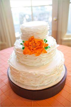 white wedding cake with orange flower #weddingcake #floralaccent #weddingchicks http://bit.ly/1kTJyMm
