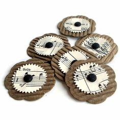 One Dozen Vintage Paper Flower Embellishments And Up-cycled Corrugated Coffee Sleeves. $5.00, via Etsy.