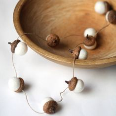 Beautifully tactile, this sweet acorn garland will add a touch of woodland wonder to your home.  Available in white or multi coloured.Drape from hooks or handles, twigs or branches or use to adorn your gifts for a unique twist.