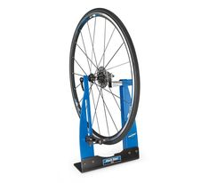 True up wapped wheels with the Park tool Home Mechanic Wheel Truing Stand. Fix sidewalk-sweeping your monster-truck or any imaginable size in between and be the blazing wheel wrench of your hood. Bicycle Tools, Bicycle Shop, Bicycle Wheel, True Up, Bike Repair Stand, Wrench Sizes, Park Tool, Brake Fluid, Home Workshop