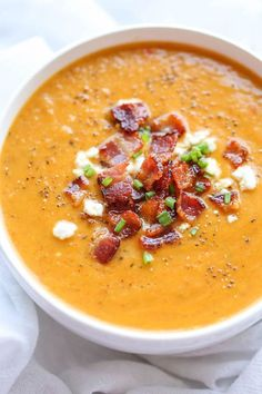 Roasted Butternut Squash and Bacon Soup - By far the best butternut squash soup ever, with the help of those crisp bacon bits blended right into the soup! @damndelicious