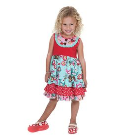 This dress features a ruffle-wreathed button placket and a twirlable tiered skirt. Pure cotton delivers a feel that's soft as can be. 100% cotton Machine wash; tumble dry Imported